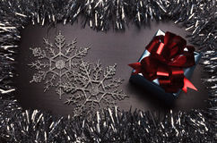 Gift box with snowflakes on wooden background Royalty Free Stock Images