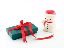 small green gift box with red ribbon bow and christmas snowman lamp isolated on white background Royalty Free Stock Image