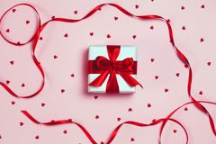 Gift box with sparkling glitter on pink background. Romantic st. Valentine`s day concept of greetings. place for your text. Top v. Iew, flat lay Royalty Free Stock Photos