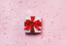 Gift box with sparkling glitter on pink background. Romantic st. Valentine`s day concept of greetings. place for your text. Top v. Iew, flat lay Stock Photos