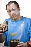 Gift box spouting powder prank. April fools day prank, gift box spouting powder Royalty Free Stock Image