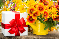 Gift box and spring flowers Royalty Free Stock Images