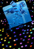 Gift box with stars on black Royalty Free Stock Image