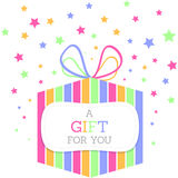 Gift Box with Stars. A striped gift box with a ribbon bow and A Gift For you text label against a background of colorful stars Royalty Free Stock Photography