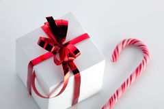 Gift box and stick of candycane Royalty Free Stock Photography