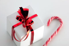 Gift box and stick of candycane Stock Photography