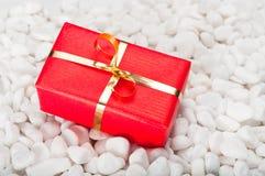 Gift Box on Stones Royalty Free Stock Photos