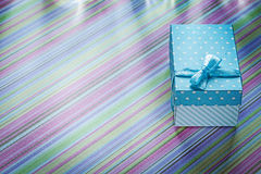 Gift box on striped tablecloth horizontal image celebrations con Royalty Free Stock Image