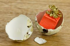 Gift box surprise concept, open egg shells symbol of born Royalty Free Stock Images