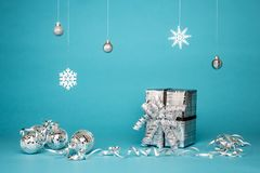 Gift Box Surrounded By Grey Baubles stock image