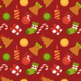 Gift box, sweet cane and Christmas decorations in seamless pattern. Gift box, sweet striped cane, Christmas candle, decorative balls, knitted sock and cookies in Stock Image