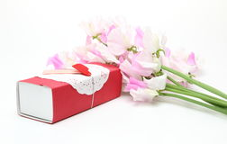 Gift box with the sweet peas Stock Image