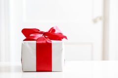 Gift box on table Royalty Free Stock Images