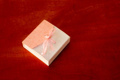 Gift Box On The Table. With a surprise in it nice pink present casket with a pink bow Stock Images