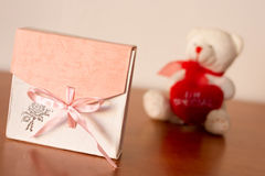 Gift Box On The Table. With a surprise in it nice pink present casket with a pink bow Royalty Free Stock Photos