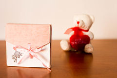 Gift Box On The Table. With a surprise in it nice pink present casket with a pink bow Stock Photo
