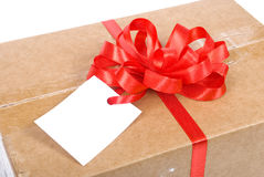 Gift box with tag Royalty Free Stock Image