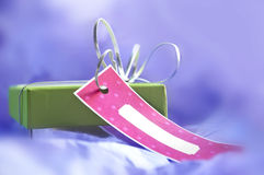 Gift box with tag Stock Images