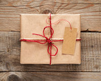 Gift box with tag close-up Stock Photography
