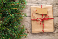 Gift box with tag and fir branches Stock Photo