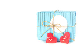 Gift box with tag  and hearts. Gift box with blank tag and heart on white Stock Photography