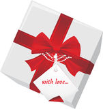 Gift box with tag and red bow Stock Photography