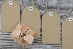 Gift box and tags Royalty Free Stock Photography