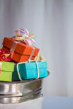 Gift box in tank. Royalty Free Stock Image