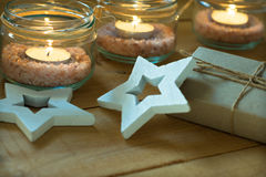 Gift box, tea lights in jars with salt, wood decoration stars, Christmas, New Year, advent Royalty Free Stock Photography