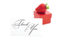 Gift box, thank you card and strawberries Stock Photos