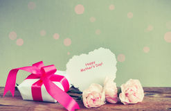 Gift box, three pink carnations, paper note Royalty Free Stock Photo