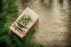 Gift box thuya pine tree branch on bagging background Royalty Free Stock Photo