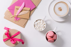 Gift box tied with pink ribbon standing on the table Royalty Free Stock Photo