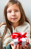 Gift box tied with a red ribbon in the hands Royalty Free Stock Images