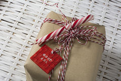 Gift box, tied with red and white cord, and candy can Stock Images