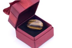 Gift Box with Tiger Eye Ring Royalty Free Stock Image