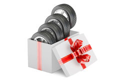Gift Box with Tires and Wheels, 3D rendering. Gift Box with Tyres and Wheels, 3D rendering on white background Stock Photo
