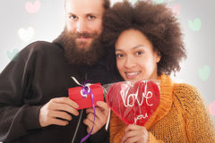 Gift box to woman and love heart for man Stock Image