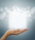 Gift box Translucent in hand Stock Photo