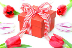 Gift box and tulips Stock Photos