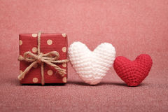 Gift box and two adorable handmade heart crochet. Royalty Free Stock Photos