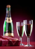 Gift box, two glasses and a bottle of champagne. Royalty Free Stock Photography