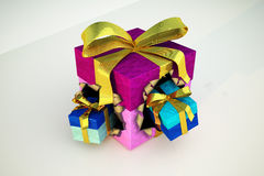 Gift box with two smaller gifts blowing out from it. Royalty Free Stock Photo