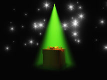 Gift box under light Royalty Free Stock Photo