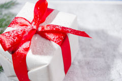 Gift box under the snow Royalty Free Stock Photos