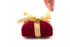 Gift box unwrapping Royalty Free Stock Images