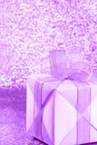 Gift Box - Valentines Day - Stock Photos. Gift Box - Valentines Day Card : purple present with ribbon bow on blurred background royalty free stock photography