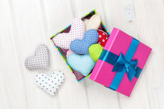 Gift box with valentines day toy hearts Stock Images