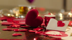 Gift box and valentines on Valentines Day. Panorama of table with preparation for Valentines Day with gift box, valentines and wedding rings on it stock footage