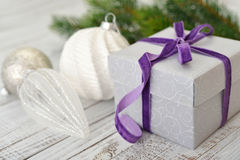 Gift box with violet ribbon Stock Photos